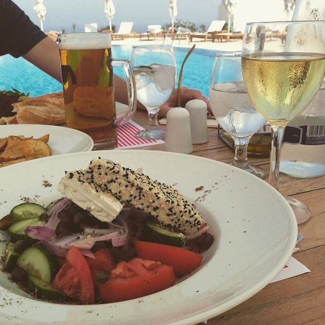 Enhance your ‪#‎lunch‬ experience with traditional Greek flavours like this. Fresh & delicious Greek salad of local ingredients served poolside at Astro Palace Hotel & Suites!   Photo: Rosedugdale at Instagram