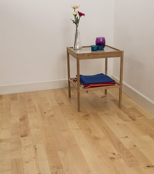 Junckers Maple Variation solid wood flooring has a rustic look with lively colour and structural graining variation between the staves along with a silky, pearlescent appearance.