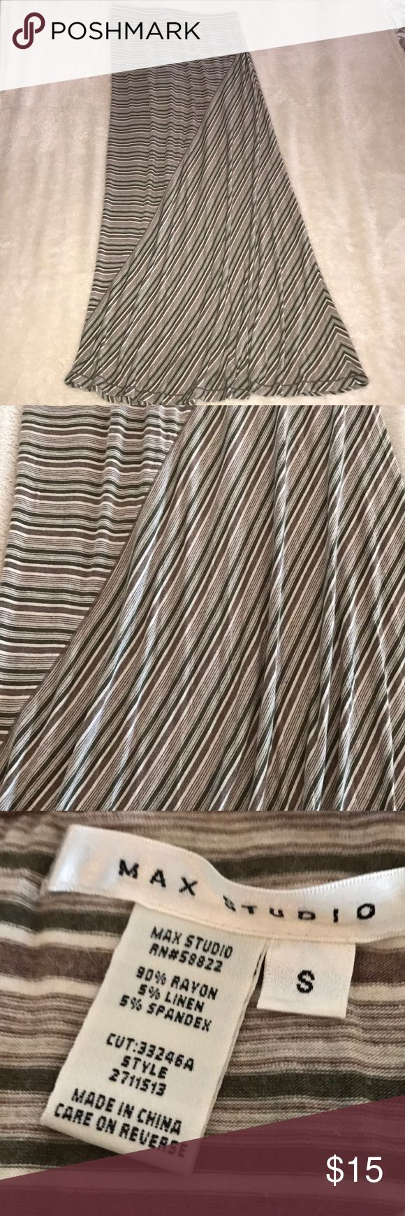 "Max Studio Asymmetrical Stripe Maxi Skirt Sz sm Soft and comfy Max Studio Maxi Skirt size Small. Asymmetrical lines are an olive green,cream and taupe color - so pretty together!!!! Measures about 42.5"" long. Waist measures 14"" and is elastic so has a lot of stretch. Excellent condition!! Smoke free home!! All of our clothes are meticulously maintained and laundered, hung to dry to prevent piling or shrinkage! All reasonable considered. Bundle more than one item and save!! Thank You!!! Max…"