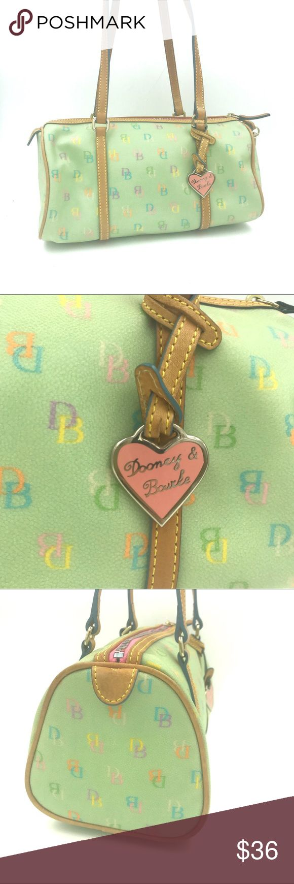 """Dooney & Bourke covered canvas DB multicolor logo Adorable mint green authentic Dooney & Bourke covered canvas DB signature multi-colored logo handbag. Has pink DB heart charm and candy colored top zipper. Interior has 1 large zip pocket, 3 accessory pockets and a key chain. K602340. One side is stained from Storage - see pic. Long double handles with blue piping. 11""""l x 6""""h x 5""""w with 9"""" handle drop. Bags Shoulder Bags"""