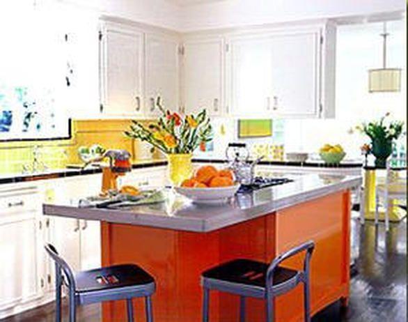 kitchen by Jeffrey Alan Marks uses a jolt of orange auto body paint