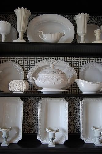 Kitchen or butlers pantry~ a select few open shelves, with checked paper behind, will make your collection really stand out..