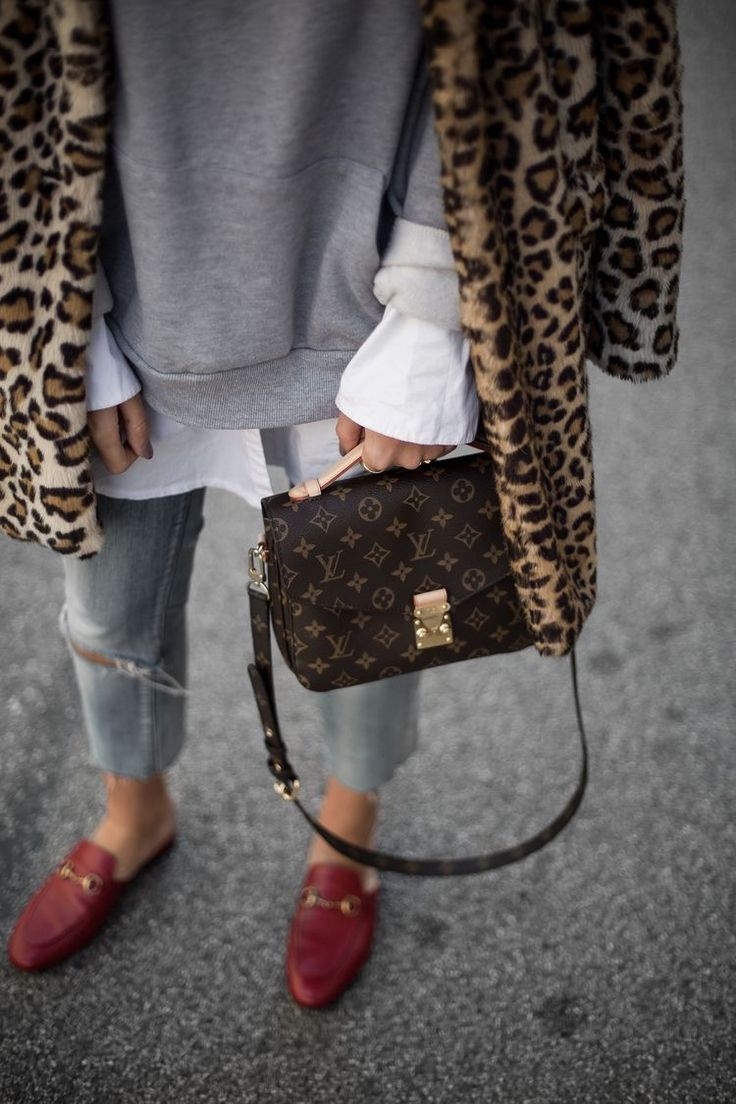 7371a6207225 Louis Vuitton satchel with leopard print jacket and red Gucci mules