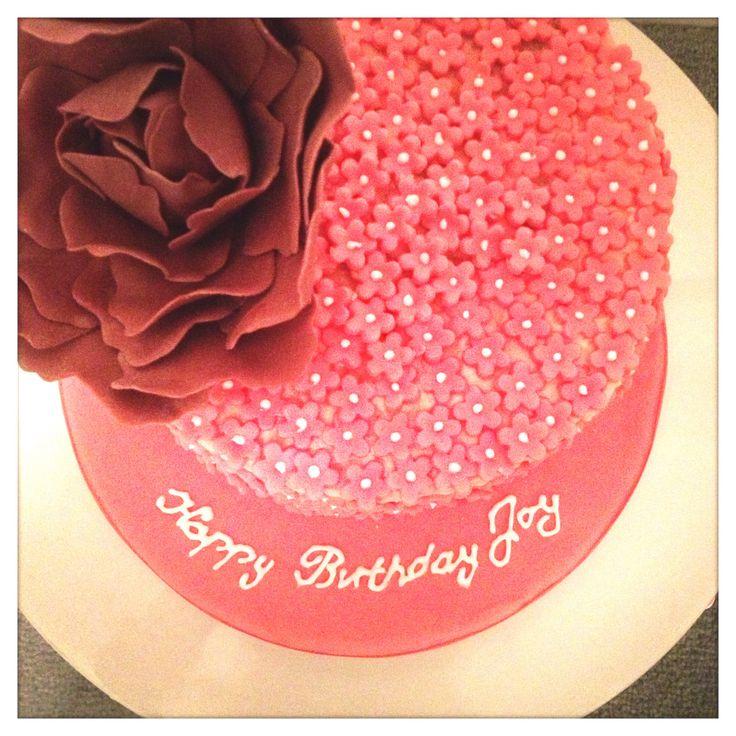 Dusky pink flower covered cake