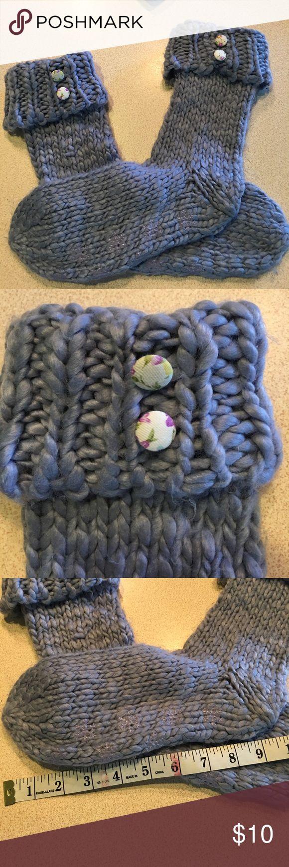 Fuzzy slippers w decorative buttons Fuzzy slippers w decorative buttons and anti slip on bottom. NWOT Accessories Hosiery & Socks