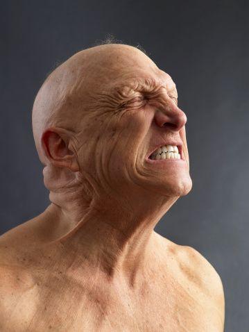 Stock Photo : Man Clenching teeth