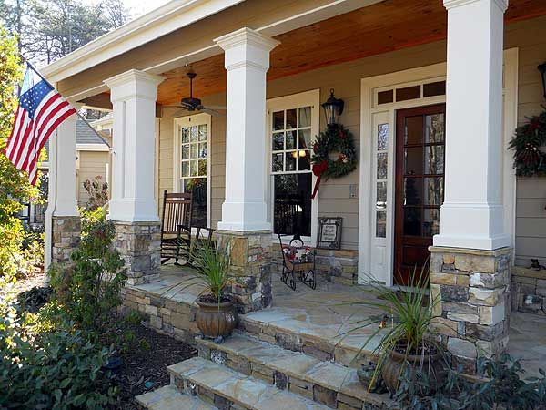 I would use this decorative design the the house I love.  1. Columns on stone.  2. The little bit of stone then siding.  3. Windows instead of doors  4. The porch floor itself stay the same on the house I love.