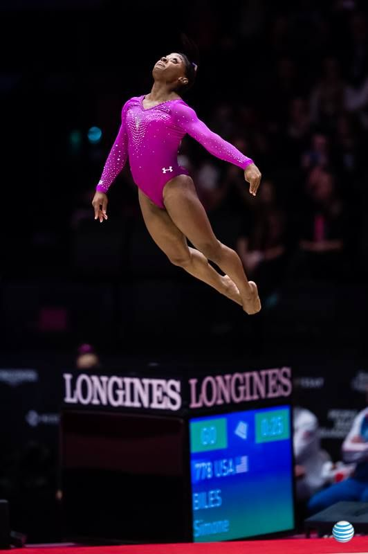Simone Biles.  Flying.