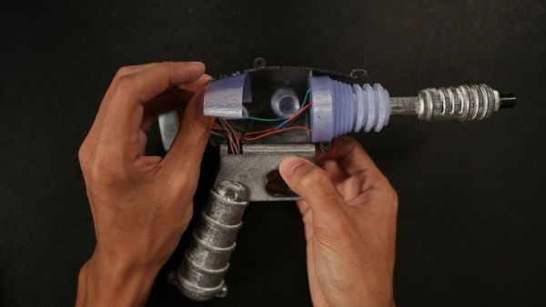 Adafruit has come up another mind-blowing project, literally: a very cool prop ray gun blaster, complete with intricate electronics that provide cool lighting and sound effects each time you pull the trigger.