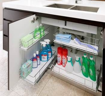 This under sink storage solution makes easy access to plumbing and water filters, while facilitating good use of storing all those bottles, sponges and brushes under the sink.