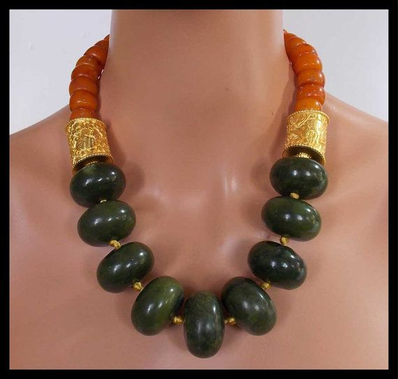Necklace by sandrawebsterjewelry on Etsy. Jade rondelles, Tibetan repousse gold cylinders, Nepalese faux-amber resin beads.