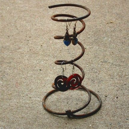 Just plain unusual but brilliant: Old bed springs! This one is sold as a set of six. You could put a bunch of these on a wall for a funky effect! These could also be sanded and painted with metallic paints. Lots more display ideas on this page!