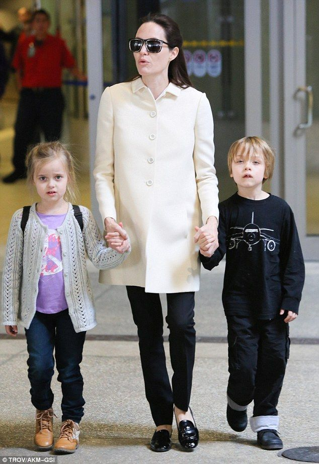 Skinny legs: Angelina Jolie arrived at LAX on Wednesday with her twins Vivienne and Knox where her alarmingly thin legs appeared to be skinnier than even her five-year-olds'