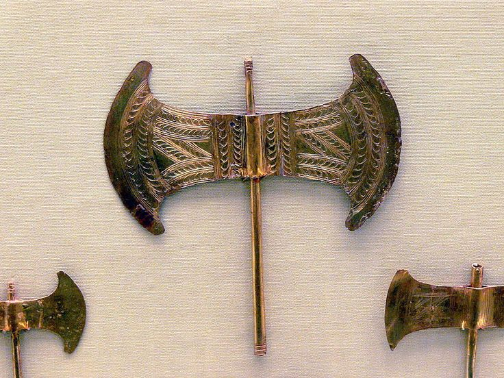 An ornamented golden Minoan labrys.  Labrys is the term for a symmetrical doubleheaded axe originally from Crete in Greece, one of the oldest symbols of Greek civilization.
