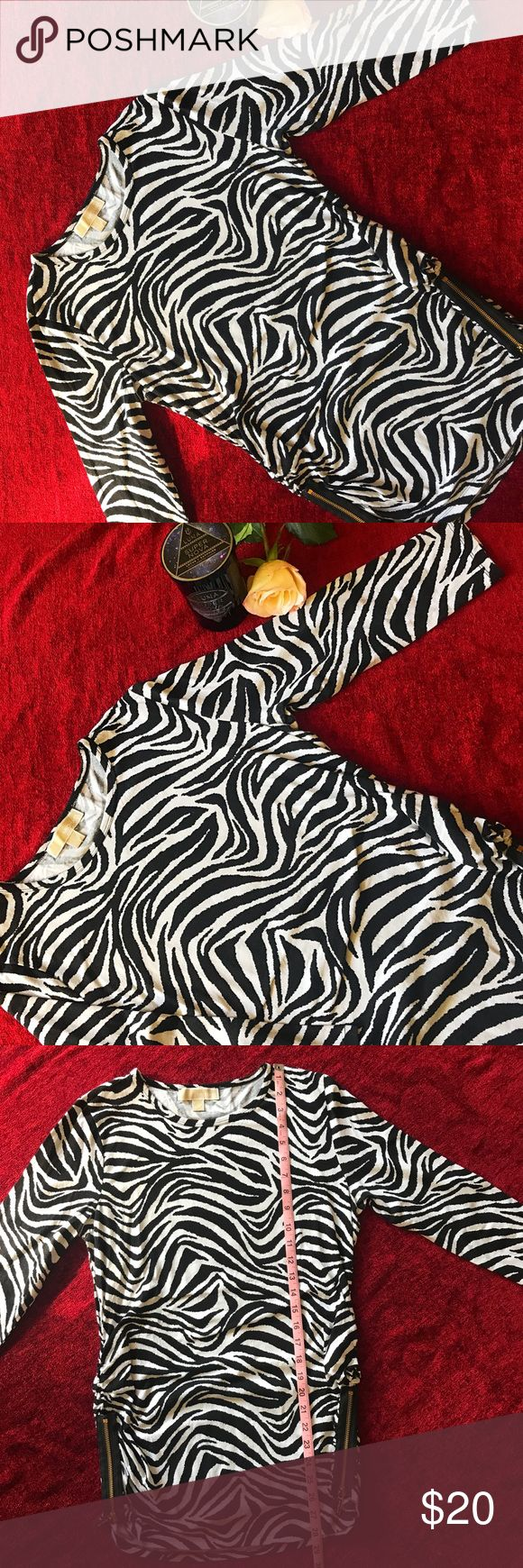 Michael Kors Zebra Top Black and white, zebra top by Michael Kors, size L. Functional side zippers. Used- in great condition. Michael Kors Tops Tunics