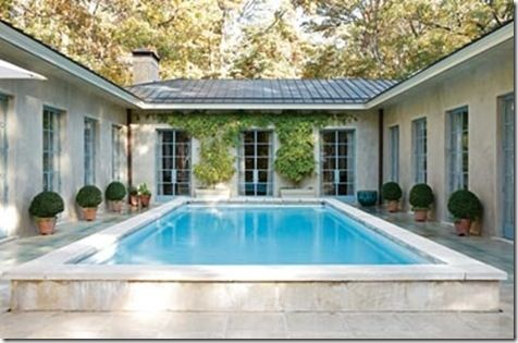Like this, but not necessarily with a pool in center.   U-shaped home lined with 10-ft french doors
