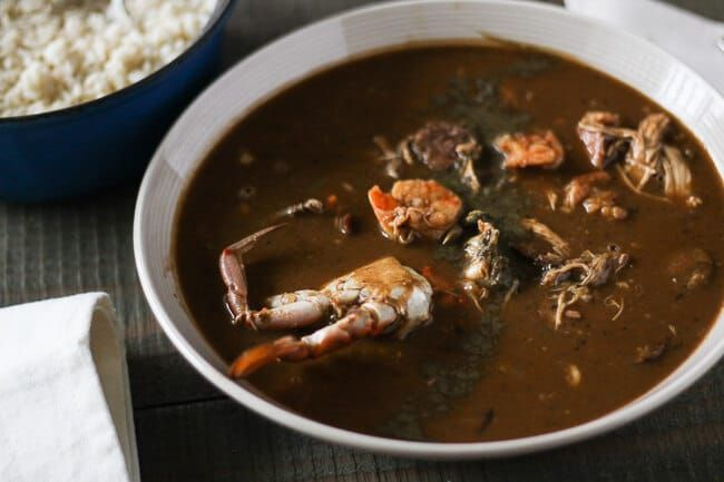 This creole seafood gumbo recipe has been in my family for years. Dark rich roux with blue crabs, shrimp and all the other fixin's. Step by step guide.