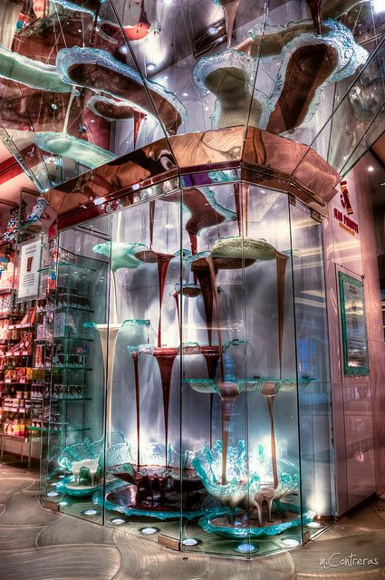 The World's Largest Chocolate Fountain~   At 27-feet tall, this chocolate fountain by Jean-Philippe Maury is the world's largest, located inside the Bellagio, Las Vegas. Not just eye candy, this fully-functional chocolate fountain circulates a whopping 2100-pounds, at the rate of 120 quarts per minute.