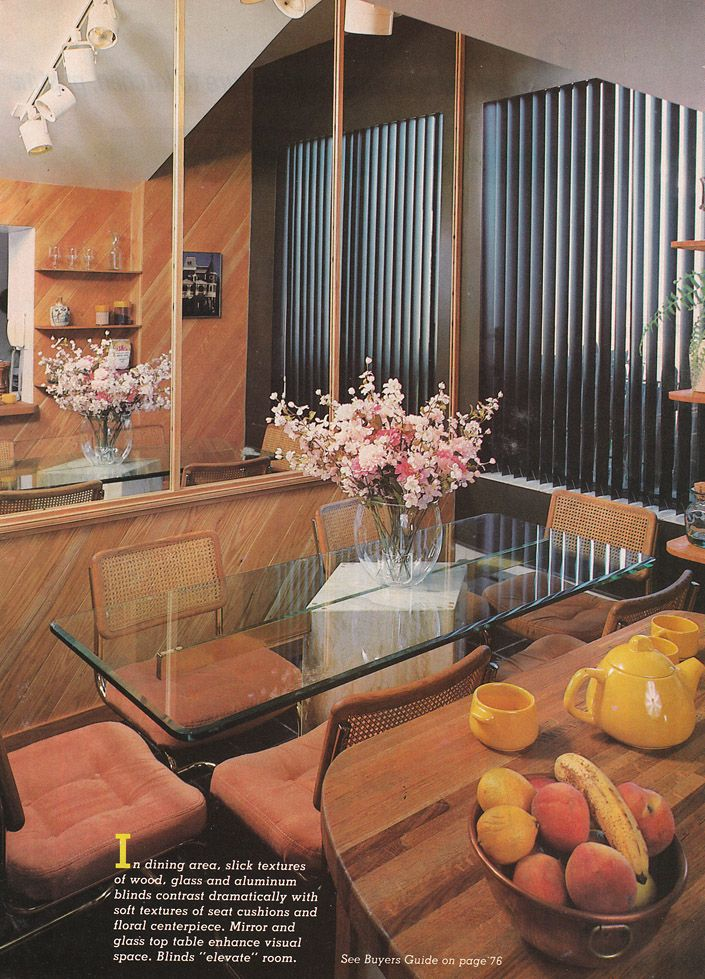 Vintage 80's Home Decorating Trends- Track Lighting, Vertical Blinds, Cane Chairs.