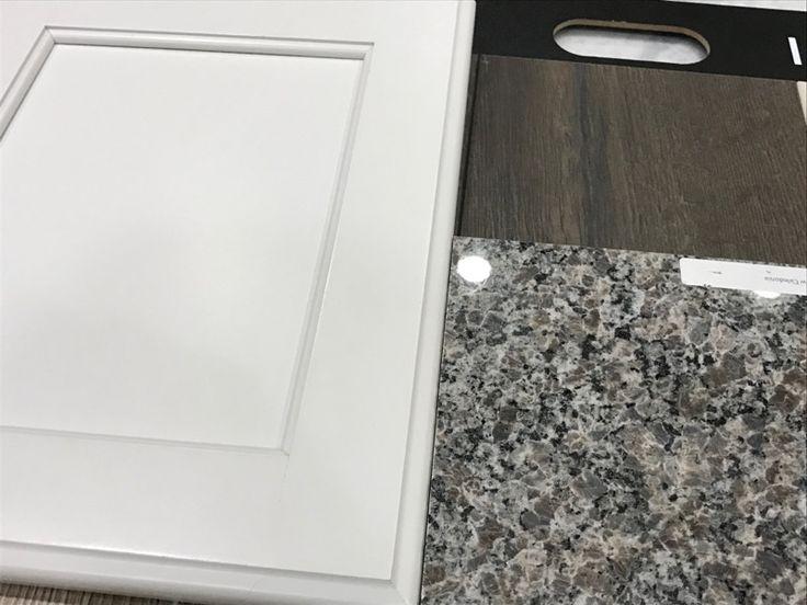 White cabinets, New Caledonia granite, and Domingo laminate flooring