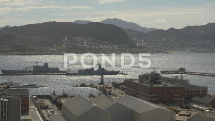 4k Speed Boat Sailing By Naval Ships At Dockyard Pier Mountains In Background - Stock Footage   by RyanJonesFilms