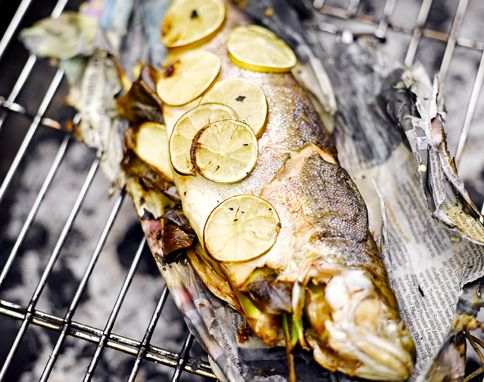 We tried this fish-wrapped-newspaper recipe by Jamie Oliver a few times on the BBQ. It's worked perfectly no matter which fish we've used.