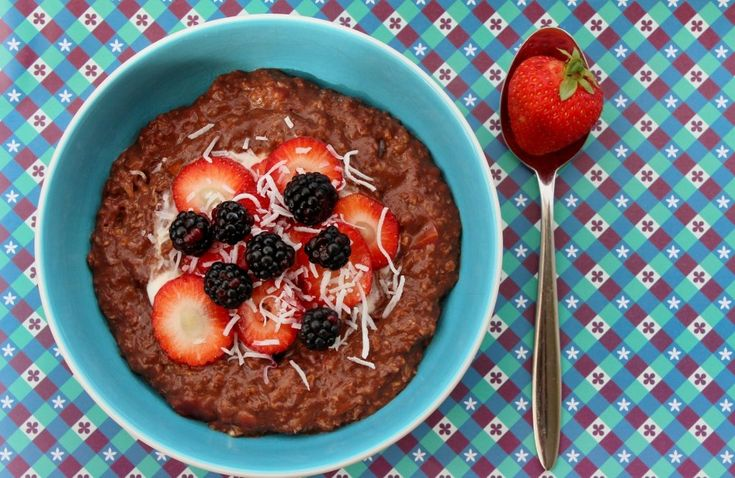 Coconut, plum and chocolate porridge or oatmeal. #Chocolate + seasonal fruit + oats + coconut: what better combination could there be? But #porridge purists - avert your eyes now! #oatmeal #plums #breakfast  #niblrecipe