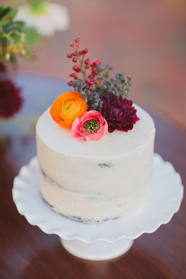 flower-topped cake, photo by Marvelous Things Photography http://ruffledblog.com/west-side-story-inspiration-shoot #weddingcake #cakes