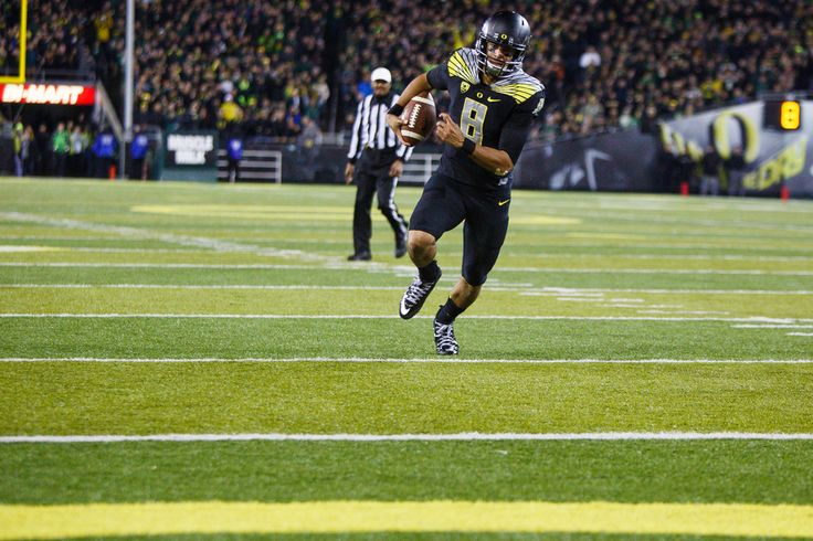 Oregon Ducks QB Marcus Mariota scores his second touchdown of the game in the fourth quarter.  Marcus Mariota: 258 yds, 2 TD, 1 INT 9 carries, 85 yds, 2 TD Game #9 Stanford at Autzen Sat 11.01.14 Final Score: 45-16 DUCKS WIN!