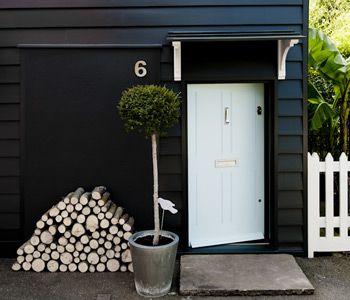 Farrow and Ball House: Off Black Exterior Eggshell  Door: Blue Ground Exterior Eggshell  Windows, Frames & Fence: Wimborne White Exterior Eggshell