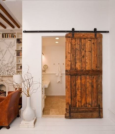 "Our barn wood door is designed to resemble the doors on most back roads found throughout the Midwest.  This design features three horizontal boards.  We also make a ""Z"" style.  Our barn wood doors can be finished in a variety of colors and any size needed.  This barn wood door is handcrafted from knotty alder."