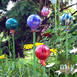 "Better hit the after CHristmas ornament sale for these.... ordinary GIANT sized ornaments, hangers removed and replaced with some type of stem you choose to use..... soem green spray paint.... and do a jewel tone drip from top to bottom on the ""globes"" and then plant them! (I would recommend sealing them first) CHEap... Dollar store here I come!"