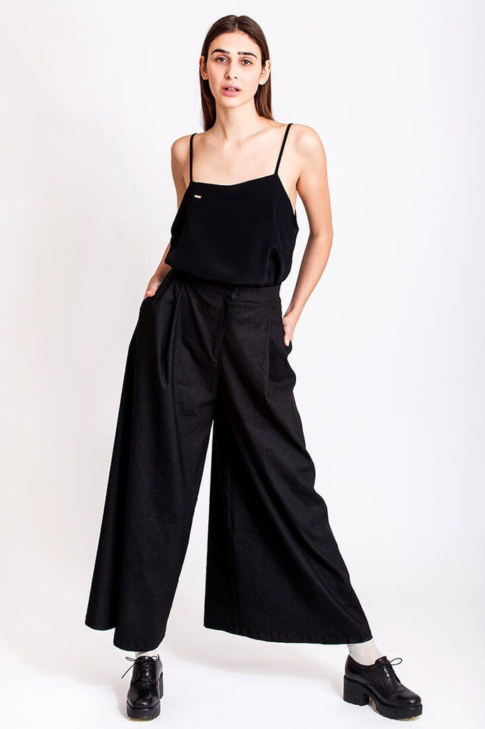 Wide black pants from Dott. It is just one of those days. You want to be stylish but at the same time you feel a bit bloated and really don't fancy those tight shorts or jeans. Anything tight actually. Dott. has just the right solution to this problem, the long, wide and high waisted pants from the Otherwise collection. You can wear them with the black viscose top and get a total Dott. look.    €135.00 REPIN TO YOUR OWN INSPIRATION BOARD