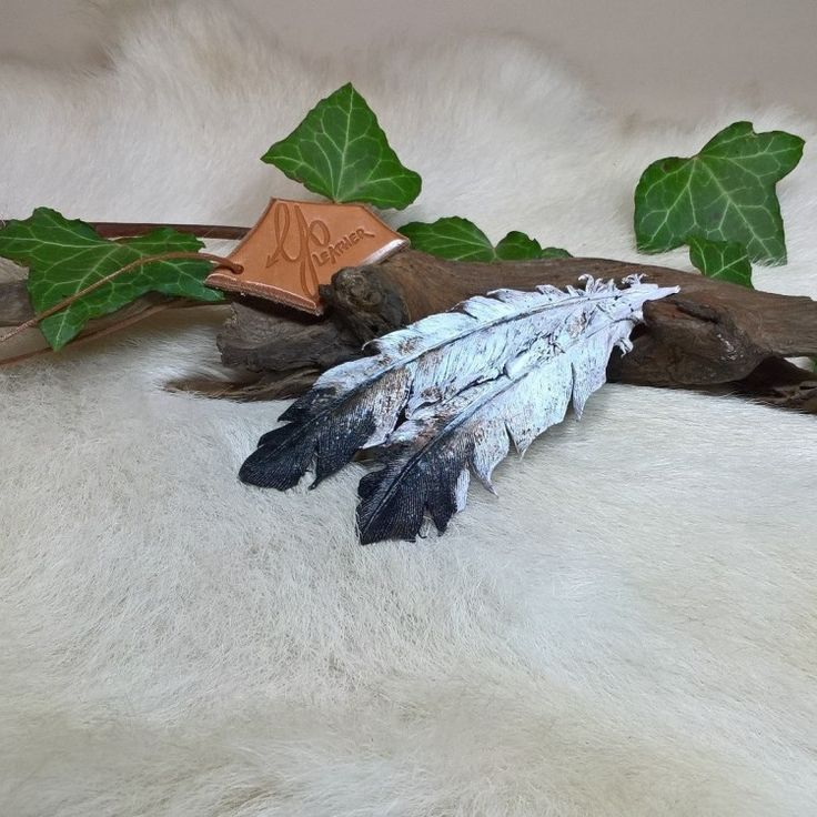 Hand crafted - unique item - in stock - No shipping costs Beautifully crafted and eye-catching! Unique double leather feathers with a medium size invisible hair clip. The feathers are crafted of vegetal tanned sheep leather, carefully sculpted, hand-painted and sealed to keep their shape. Length of the large feather is 5'', length of the hair clip is 2 3/4''.