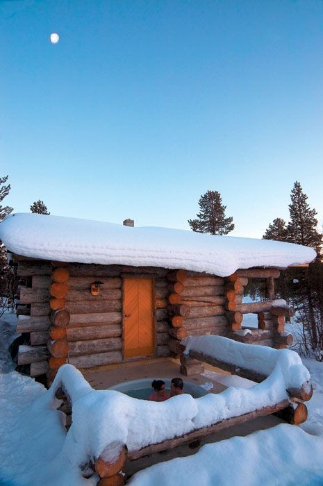 Rustic Cabin Hotel Kakslauttanan in Finland. You can see the Northern Lights from there. Love the add on hot tub!
