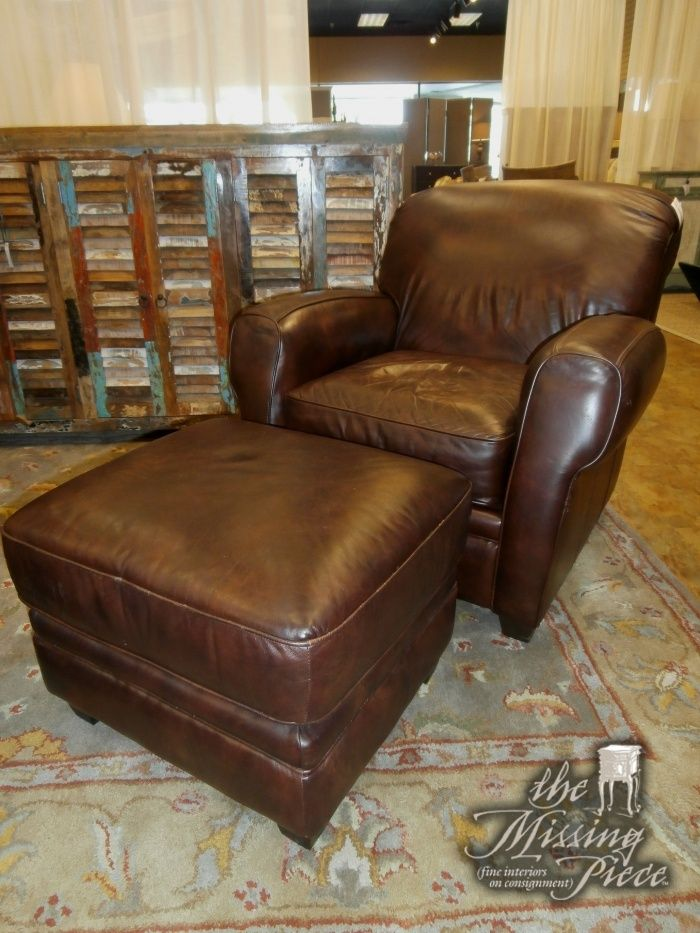 Leather, rolled arm club chair and matching ottoman by