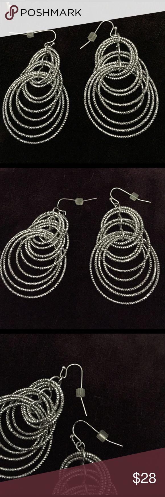 Lia Sophia silver dangling earrings Lia Sophia silver dangling earrings, very shiny and sparkly, 2.5 inches in length, each earring has 9 dangling engraved circles, NWOT no tarnishing Lia Sophia Jewelry Earrings