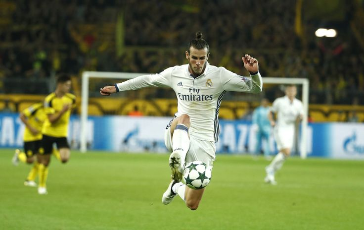 Real Madrid's Welsh forward Gareth Bale vies during the UEFA Champions League first leg football match between Borussia Dortmund and Real Madrid at BVB stadium in Dortmund, on September 27, 2016.