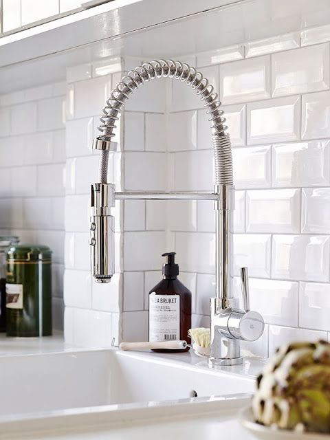 This industrial type faucet is very handsome, versatile and functional.  Available for under $200 too.