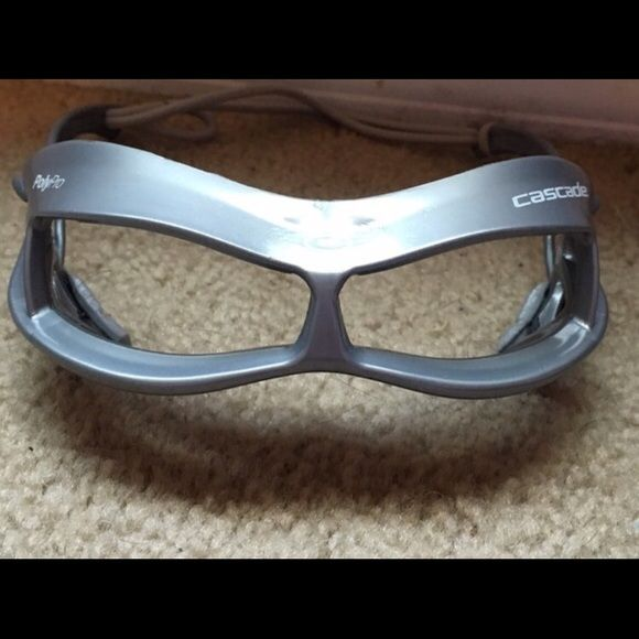 Grey polypro cascade lacrosse goggles. Grey lacrosse beginners goggles. I got these when I first started playing lacrosse and since then purchased a new pair. Other