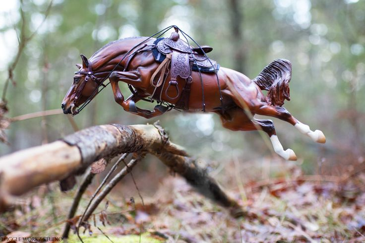 """Hornet"" sculpted by Maggie Bennett, painted by Wiggle Workz Studio, tack by A. Teller. Hornet is painted to glowing red chestnut and is a traditional scale artist resin model horse."