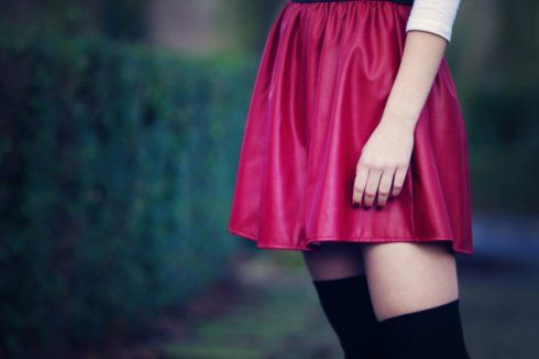 @Primark red faux leather skirt, boat neck white tee and black over the knee socks, @Topshop black cutout flat boots http://www.jolihouse.com/red-primark-skirt-zooey-deschenel-hair/