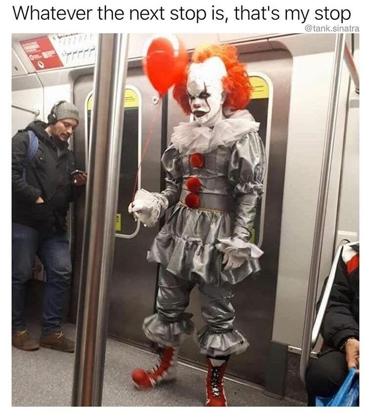 32 - Scary clown on the subway with a lone red balloon