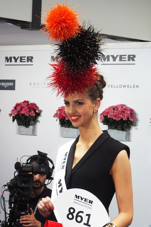 Alice Anderson in the award winning Fireworks inspired headpiece by Hats Life milliner, Cynthia Jones-Bryson.