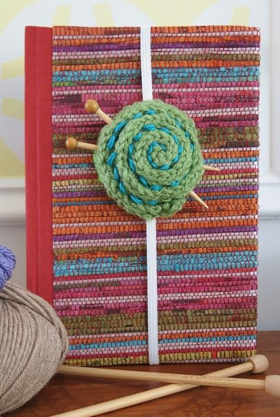 Free Knitting Pattern for Yarn Ball Bookmark - Easy knitting pattern for band-style bookmark constructed of i-cord to look like a ball of yarn. Instructions for the tiny knitting needles included. Designed by Donna Herron