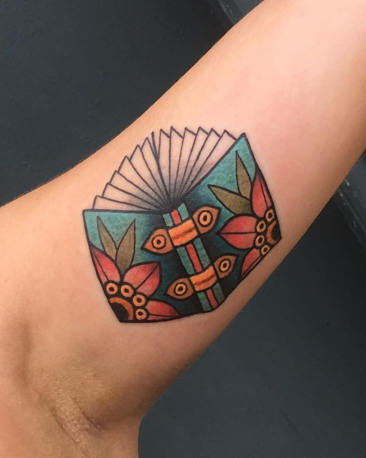 Traditional book tattoo by Allie Marie at Revolution tattoo in Chicago.