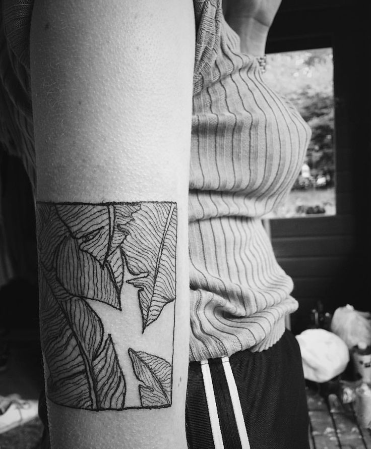 Palm leaf in a square by Swedish tattoo artist @thuremelander