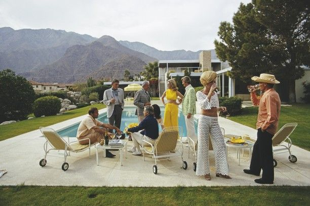 'Desert House Party' 1970  by Slim Aarons   Open Edition or Limited Edition Estate Stamped Print (edition size 1/150).  A poolside party at a desert house, designed by Richard Neutra for Edgar J. Kaufmann, in Palm Springs, January 1970. Featured  Available to order online in various sizes and frames and worldwide shipping available also - www.GALERIEPRINTS.com