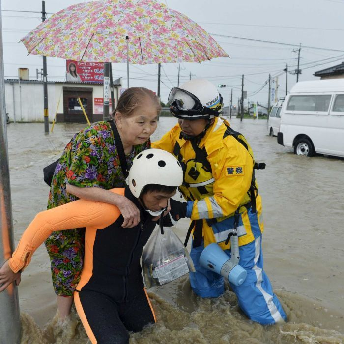 Tens of thousands of people have been ordered to flee homes in eastern Japan after torrential rains trigger floods and landslides.