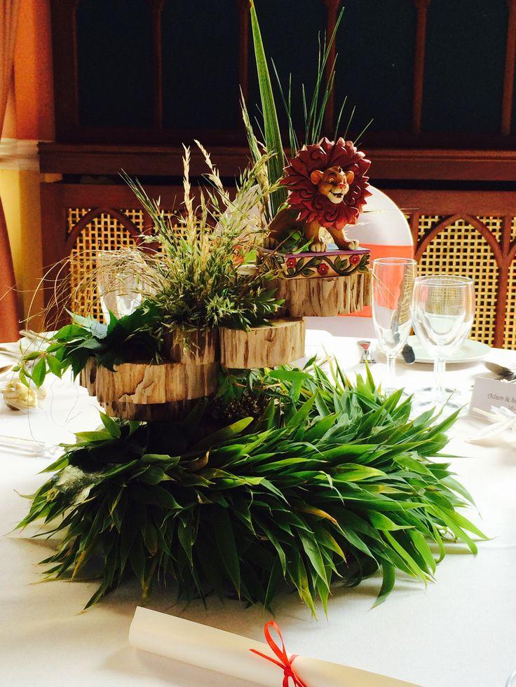 Wedding reception Disney theme Lion king table arrangement ...